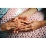 elder-holding-hands